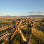 fence in montana near vacation rental properties on the J Bar L Ranch